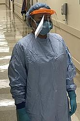 A doctor in full PPE.