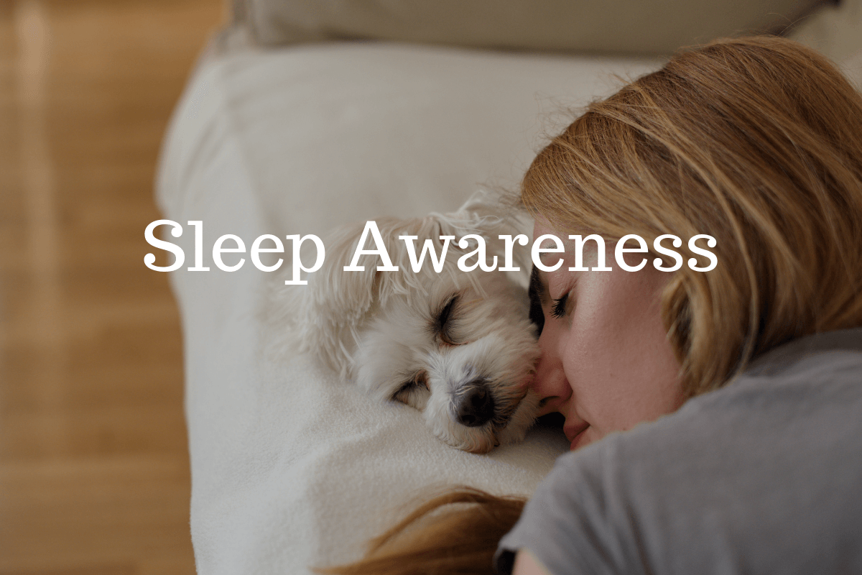 Woman sleeping with dog. Sleep awareness is a serious health concern.