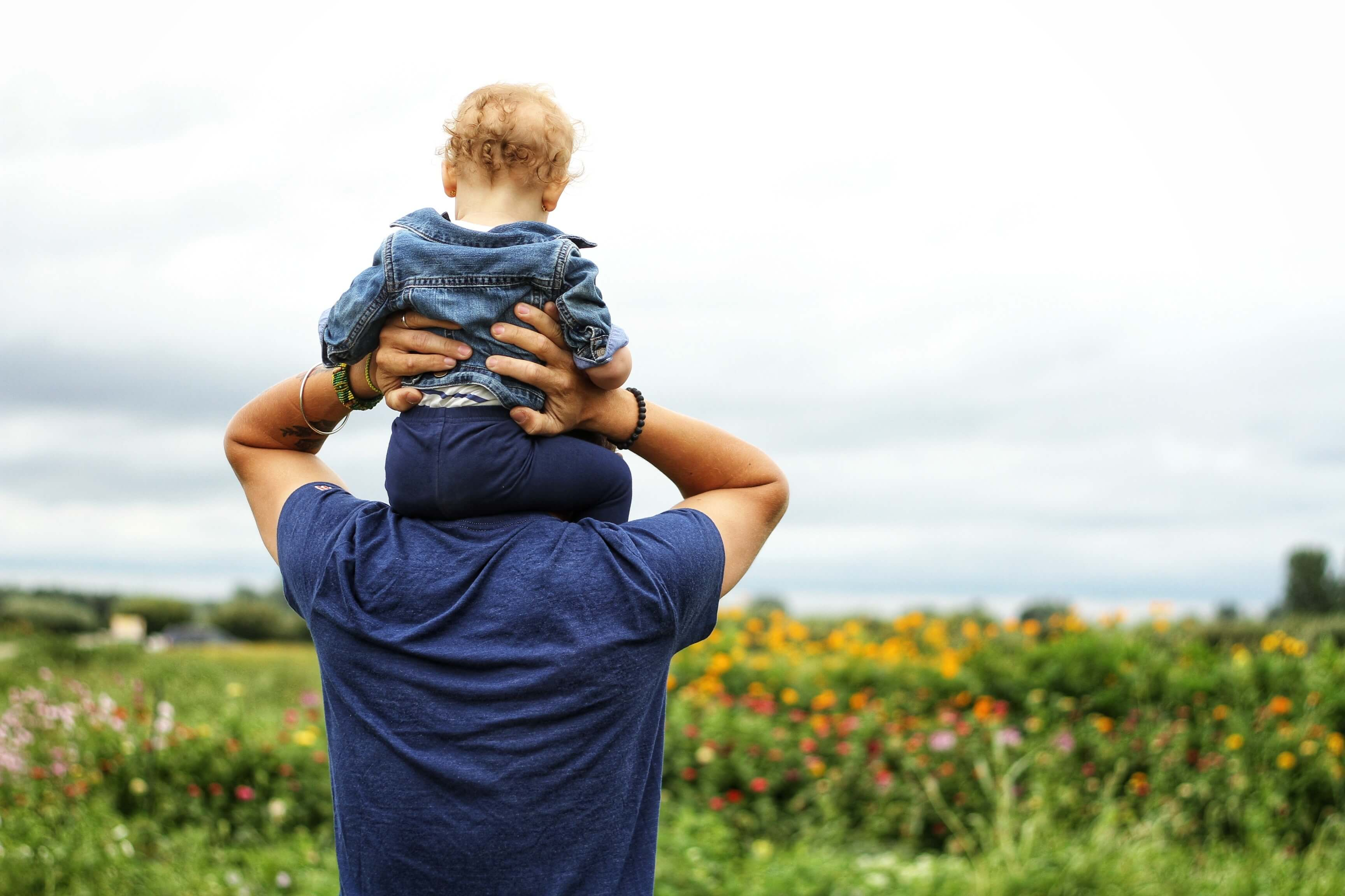 Man and son in a meadow. It's important to support child abuse prevention awareness.