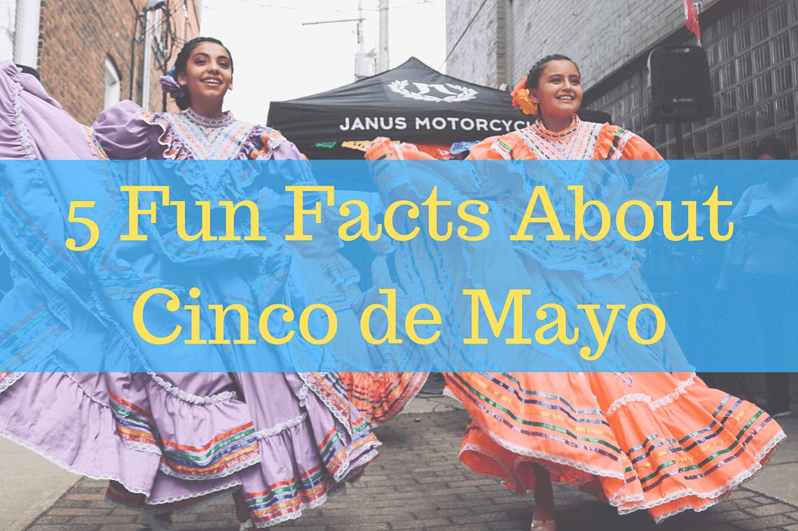 Girls dancing in bright dresses in the street celebrating Cinco de Mayo.