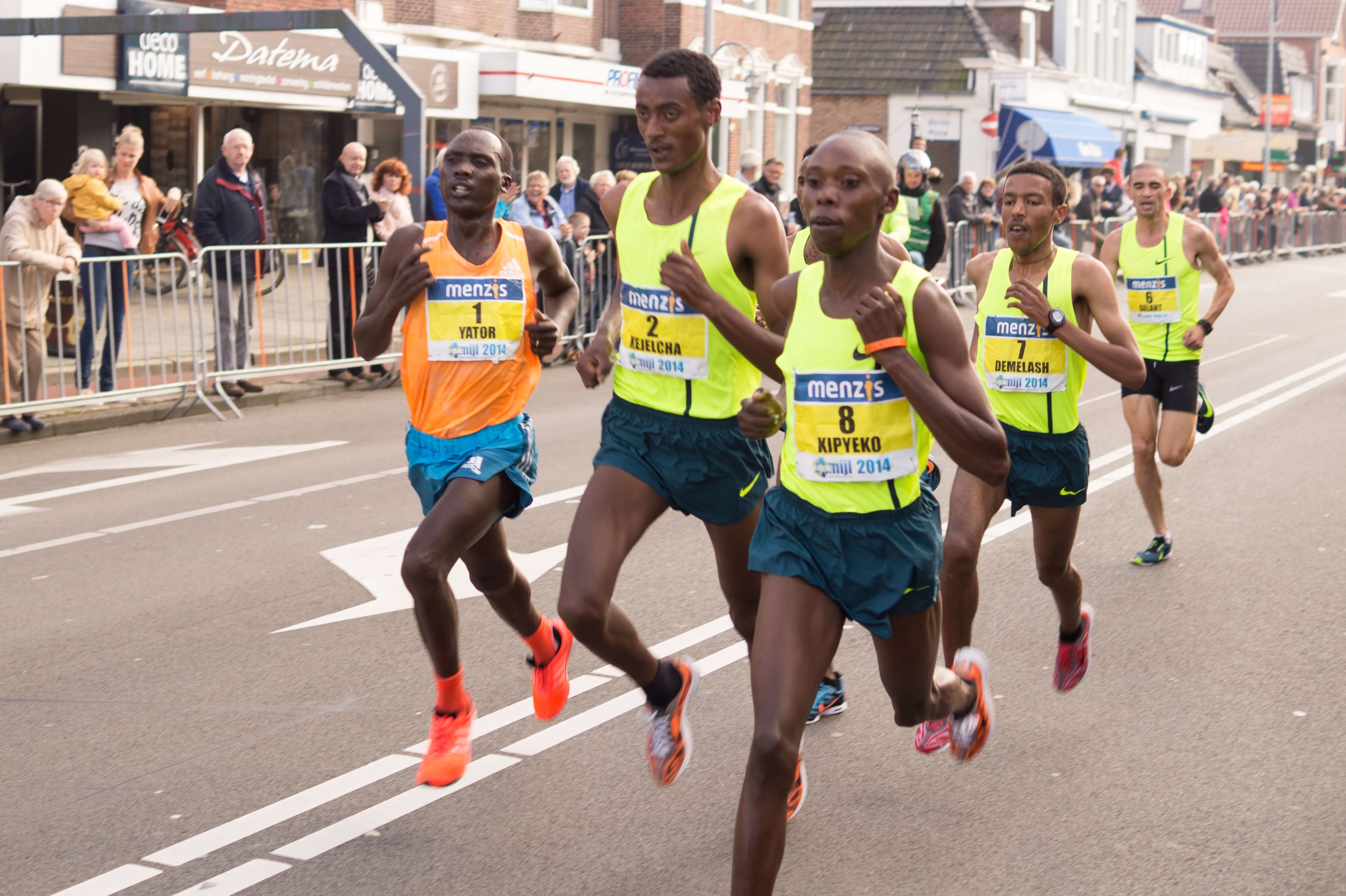 Marathons runners are wearing silicone wristbands.