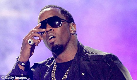 P. Diddy wearing a black wristband.
