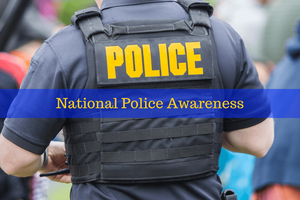 A police officer standing. Celebrate national police awareness by purchasing a wristband.