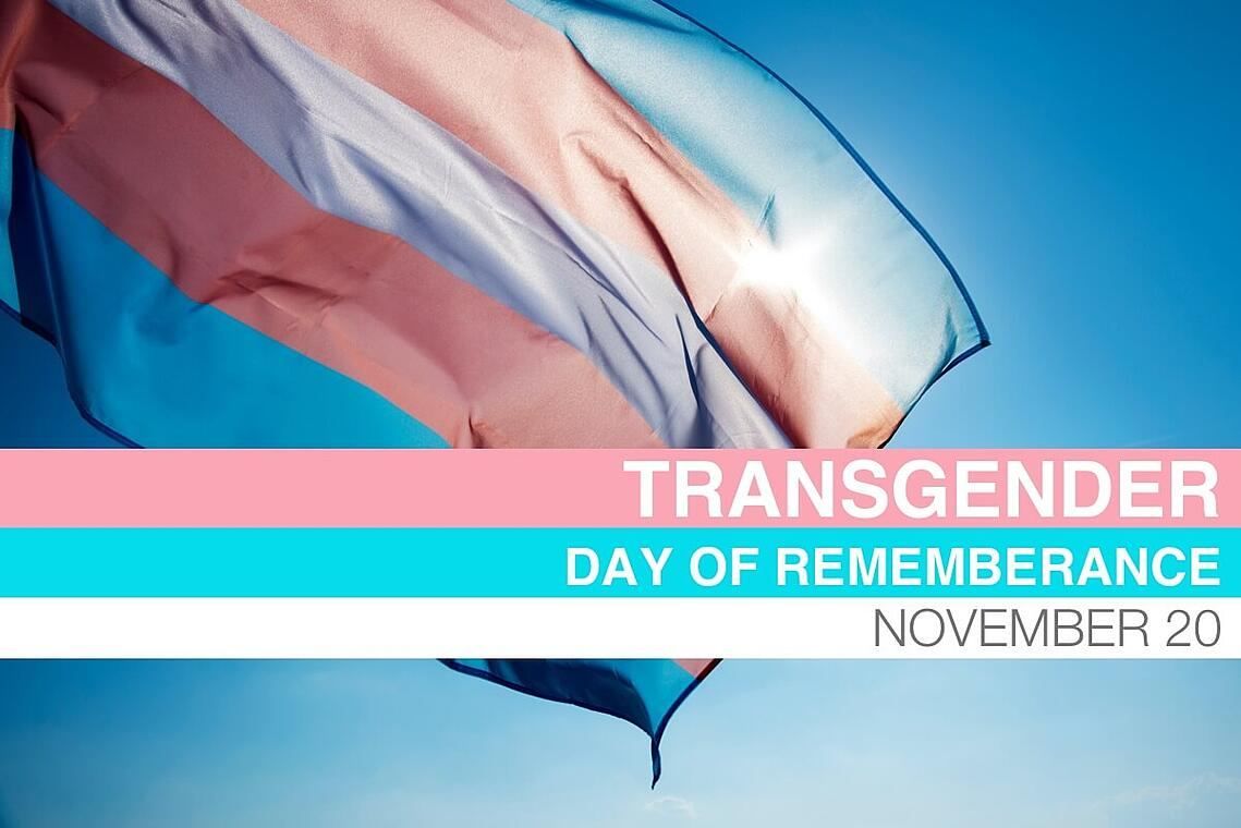 The pink, blue, and white flag represents Transgender Day of Remembrance.