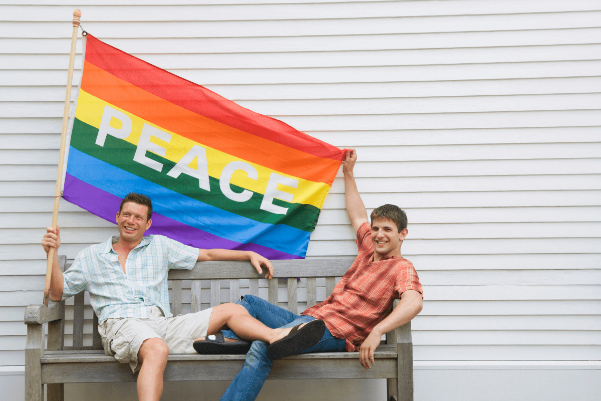two-men-holding-a-gay-pride-flag