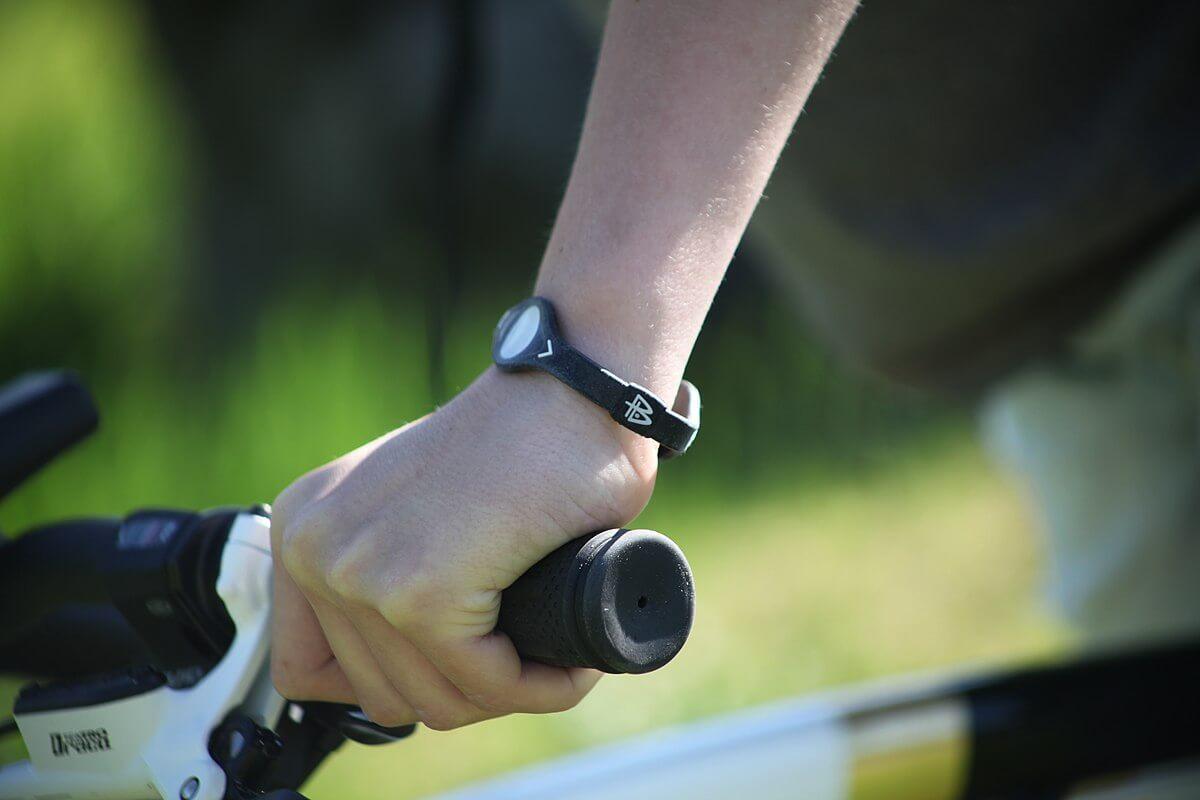 An individual wearing a black balance wristband.