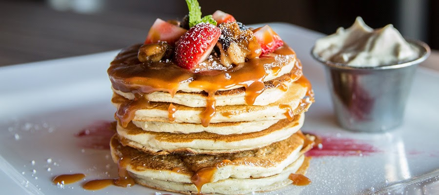 Delicious pancakes with fruit on top