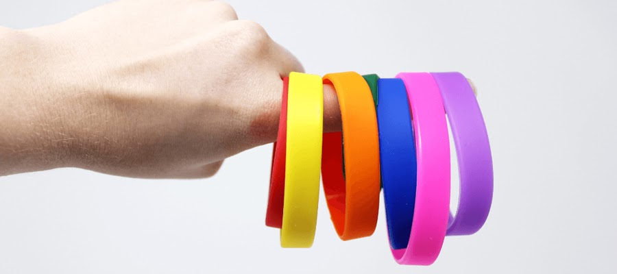 Multiple silicone wristbands in various bright colors